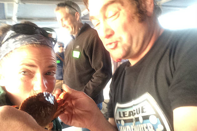 Lori kissing a crab with Diver Ed