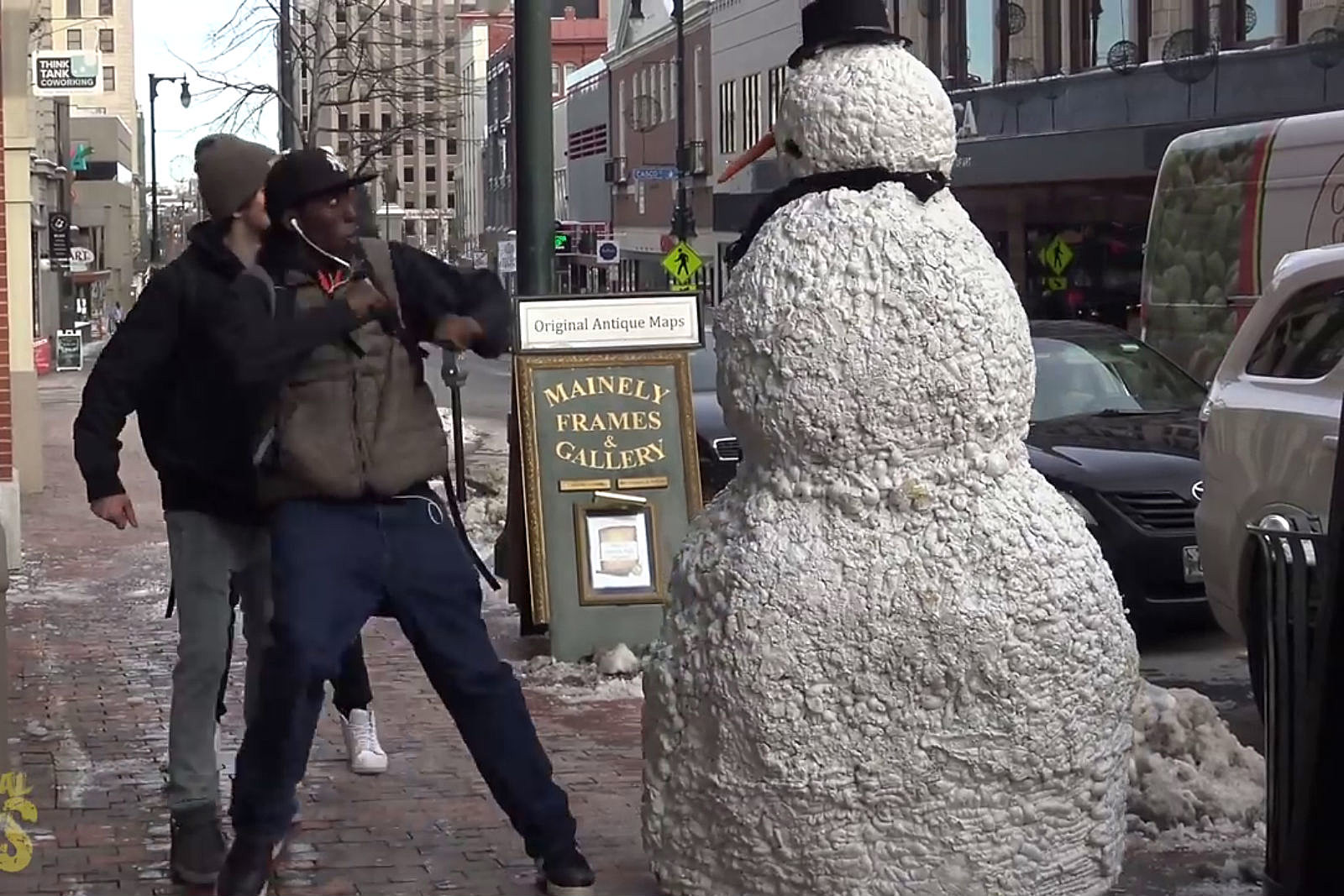 scary snowman in portland makes people jump as it comes to life